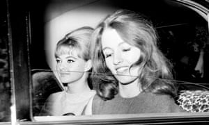 Christine Keeler, (right), and Mandy Rice-Davies leaving the Old Bailey after the first day of the trial of Dr Stephen Ward. 22 July 1963.