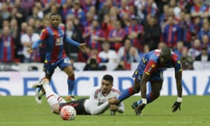 Chris Smalling fouls Yannick Bolasie