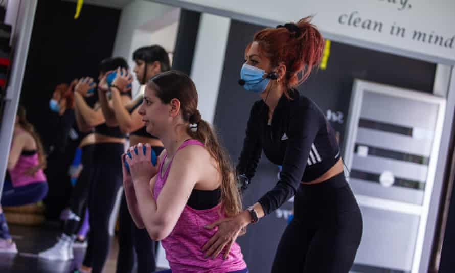 woman trains with trainer at gym