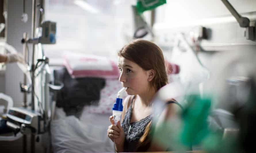 A teenager receiving hospital treatment for cystic fibrosis