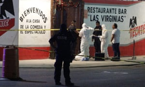 Police officers search evidence at Las Virginias in Playa del Carmen on 7 January.