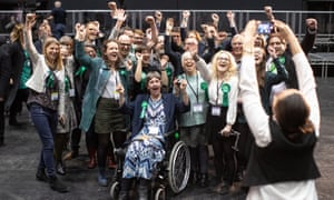 Green party activists celebrate their results at Manchester central convention complex