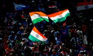 India fans celebrate the wicket of Bangladesh's Shakib Al Hasan.