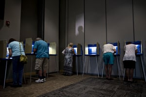 Voters fill out ballots in Janesville, Wisconsin on 14 August 2018.