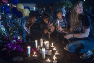 <strong>Roanoke, Virginia, US</strong> People participate in a candlelight vigil placing their candles near the memorial shrine of balloons and flowers on the front driveway of WDBJ-TV's television studios. The brazen killing of two US journalists during a live television broadcast by a former reporter fired by the station reignited calls for tougher gun control in America