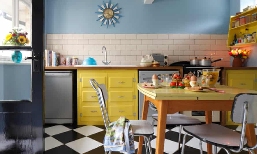 The bright yellow kitchen with a Formica table.