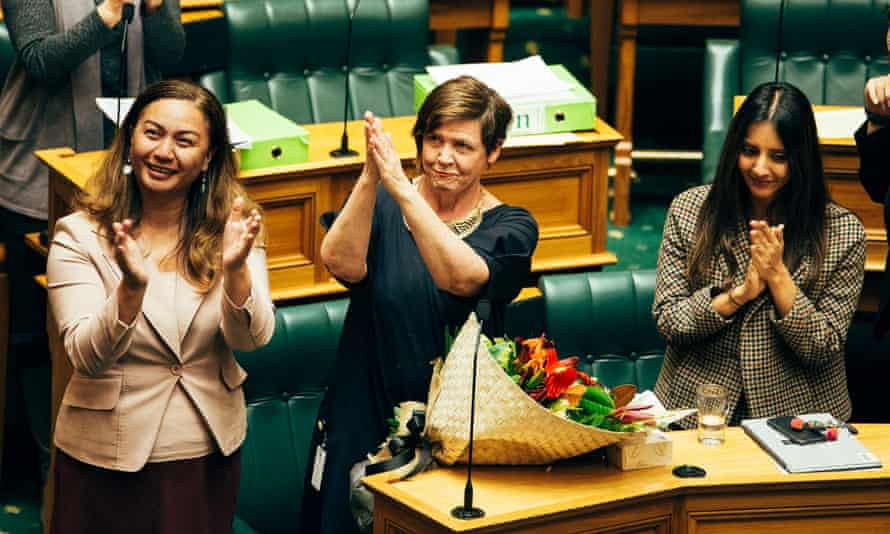 Jan Logie, centre, welcomes the passing of legislation in New Zealand to give domestic violence victims 10 days of paid leave.