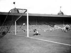 George Farm, Blackpool's goalkeeper, looks dismayed as the Lofthouse's shot hops over him and into the net!