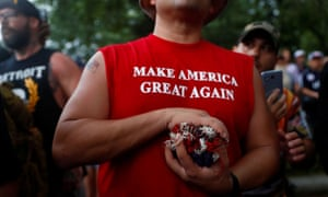 "Independence Day celebrations in WashingtonA man wears a shirt with ""Make America Great Again"" printed on it in front of the White House during a Fourth of July Independence Day protest in Washington, D.C., U.S., July 4, 2019. REUTERS/Eric Thayer"