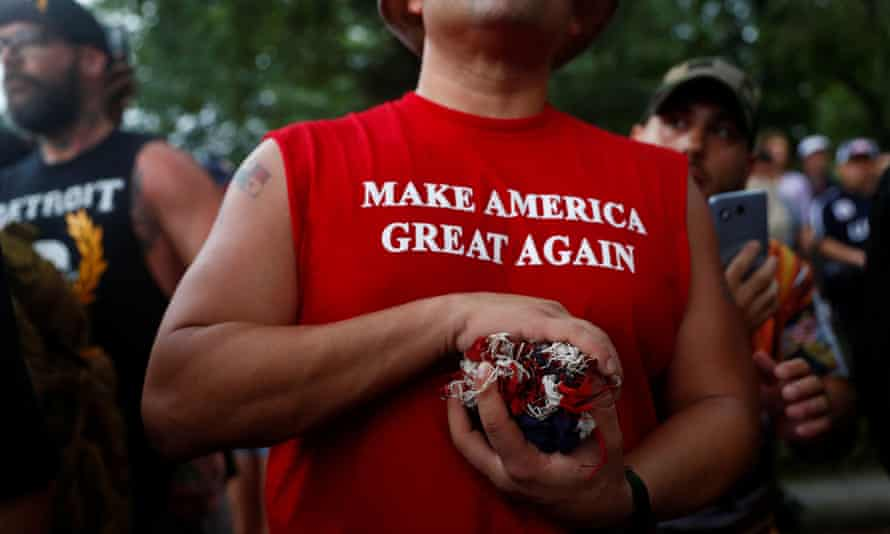 """Independence Day celebrations in WashingtonA man wears a shirt with """"Make America Great Again"""" printed on it in front of the White House during a Fourth of July Independence Day protest in Washington, D.C., U.S., July 4, 2019. REUTERS/Eric Thayer"""