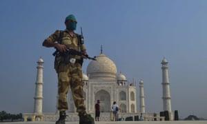 A guard stands outside a military Taj Mahal