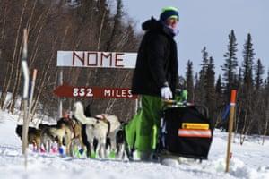Signs point toward Nome, Alaska, 852 miles away, as Ryan Redington leaves the Finger Lake, Alaska, checkpoint, heading toward the Alaska Range mountains, Monday, March 9, 2020, during the Iditarod trail sled dog race.