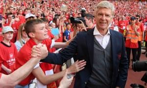 Arsène Wenger greets fans after the game.