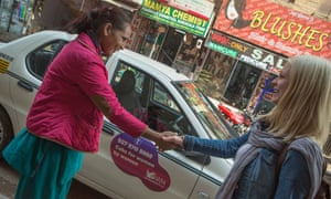 female chauffeur meets tourist in New Delhi