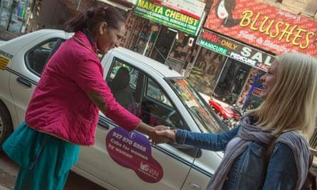 female chauffeur meets tourist in New Delhi
