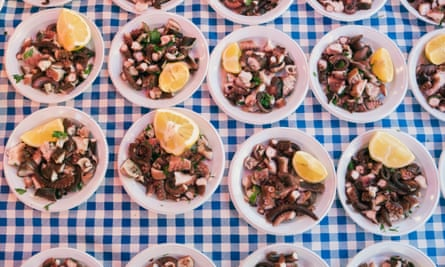 Dishes of octopus at Ballarò Market, one of the most ancient open-air markets in Palermo.