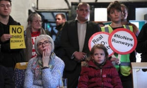 Residents of Harmondsworth village watch television in the Five Bells pub as Transport Secretary Chris Grayling announces the government's decision to build a new runway at Heathrow Airport.