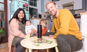 Stuart Heritage with his wife Robin and their sons Ned, one, and Herbie, two, with the Amazon Echo device at their home in Kent.