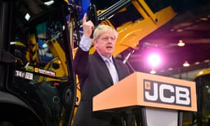 Boris Johnson gives a speech in front of a JCB