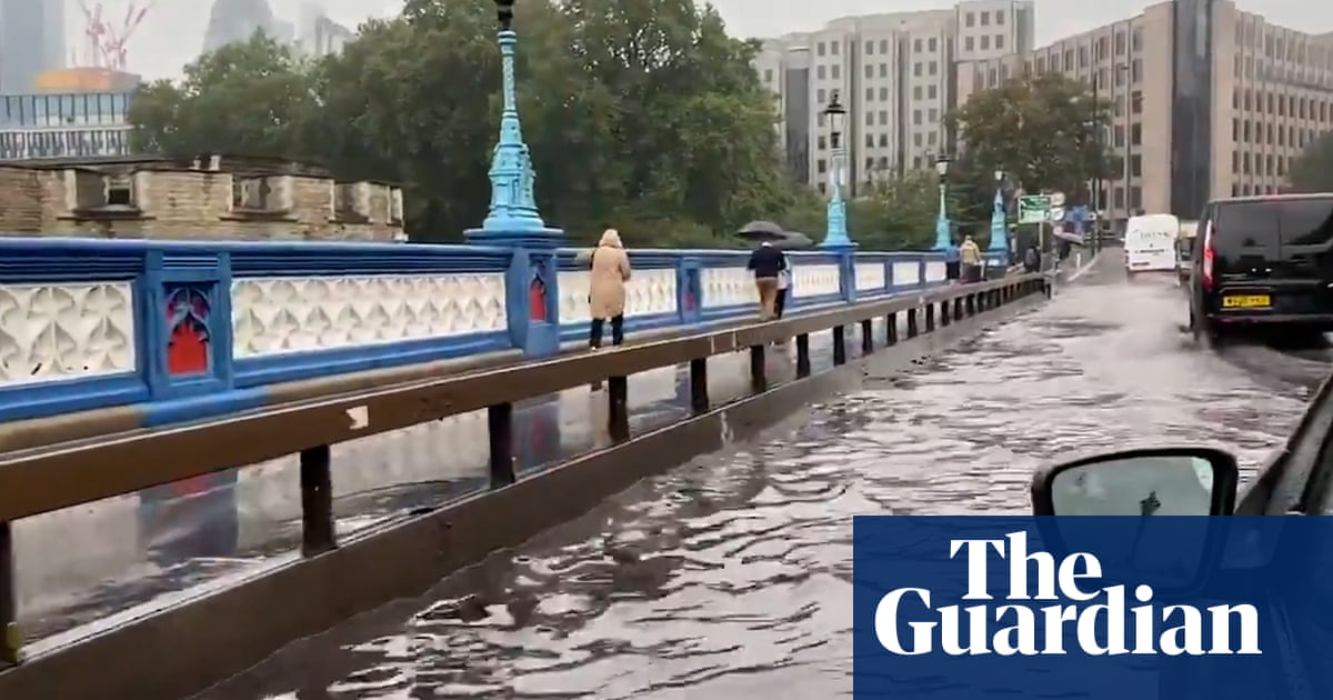 Tower Bridge in London flooded after torrential rain – video