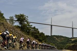 The peloton passes the Millau Viaduct