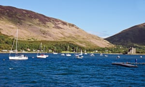 Lochranza Castle ruin and moored boats in Loch Ranza on the island of Arran