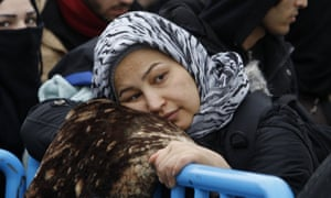 A refugee waits in Gevgelija, Macedonia, to board a train towards Serbia on her way to more prosperous areas of the EU.