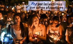 Demonstrators light candles during a march for the peace in Cali, Colombia.