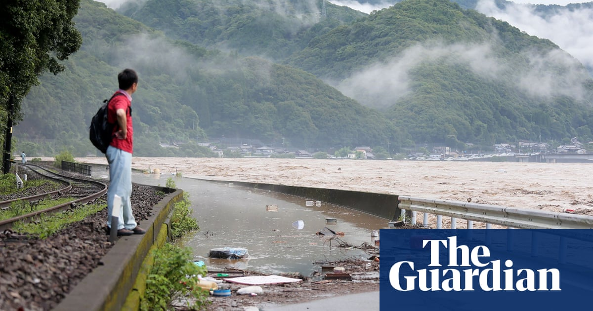 At least two people die as record heavy rain lashes Japan - the guardian