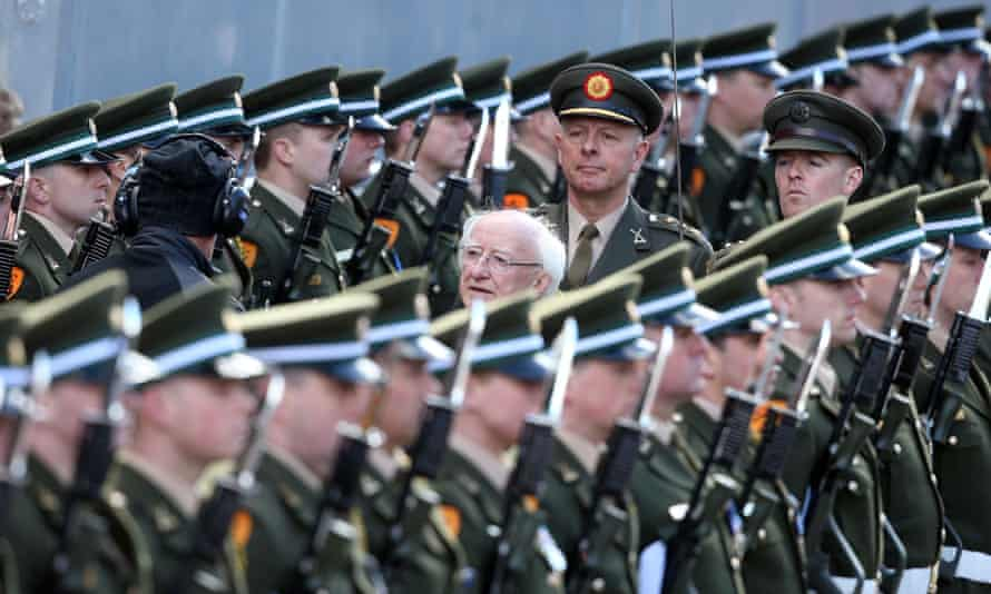 Ireland's President Michael Higgins inspects the guard of honour at the GPO.