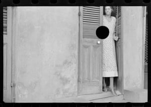 Woman in doorway, with large black circle