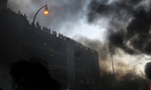 A cop car burns during a protest against the death in Minneapolis police custody of African-American man George Floyd, in Atlanta, Georgia, US May 29, 2020.