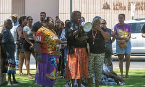 Family and supporters gather outside the police station in Alice Springs to protest against the shooting of Kumanjayi Walker.