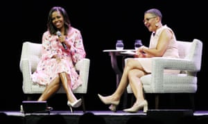 Michelle Obama on stage with Lauren Y Casteel at the event.