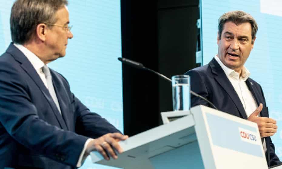CDU party chairman Armin Laschet (left) and CSU leader Markus Söder share a podium in Berlin