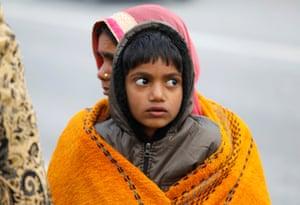 New Delhi, India A boy and a woman