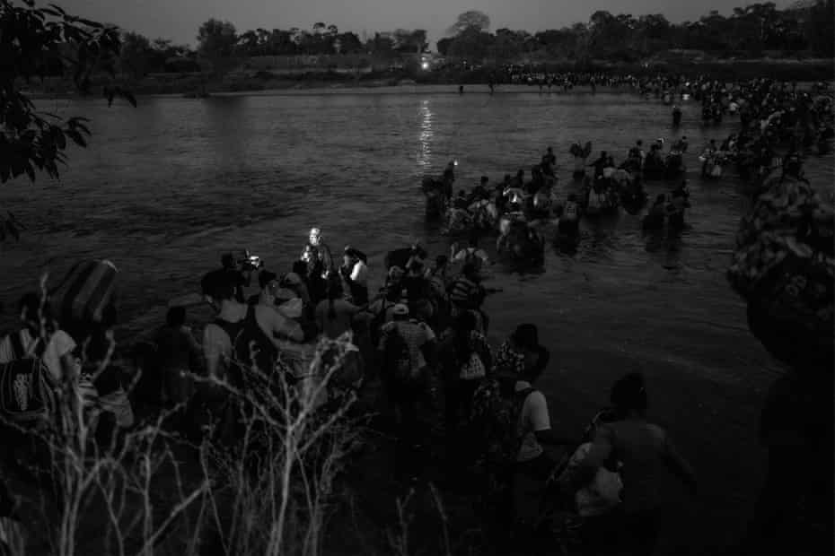 People cross the Suchiate River as they enter Mexico from Guatemala
