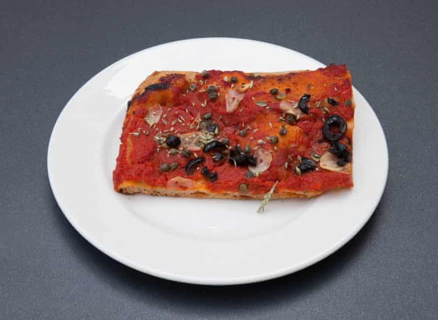 Pizza with tomato, olives, garlic, dried datterini, capers, oregano at Mike's, Peckham, London.