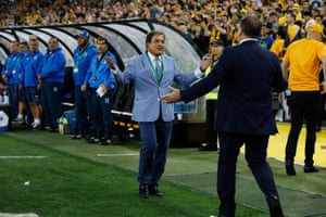 Australia coach Ange Postecoglou greets his opposite number, Jorge Luis Pinto, directly before kick-off.
