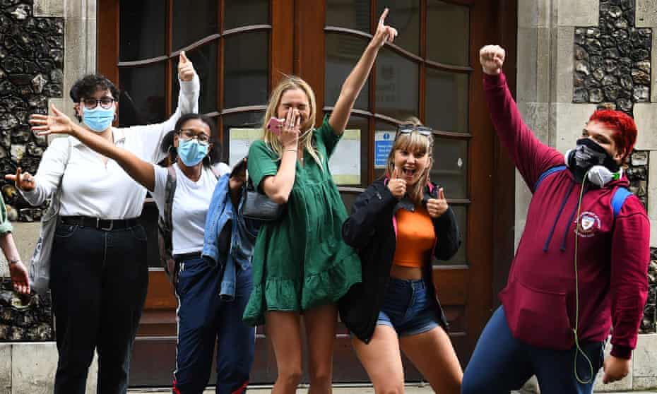 Masked students celebrate