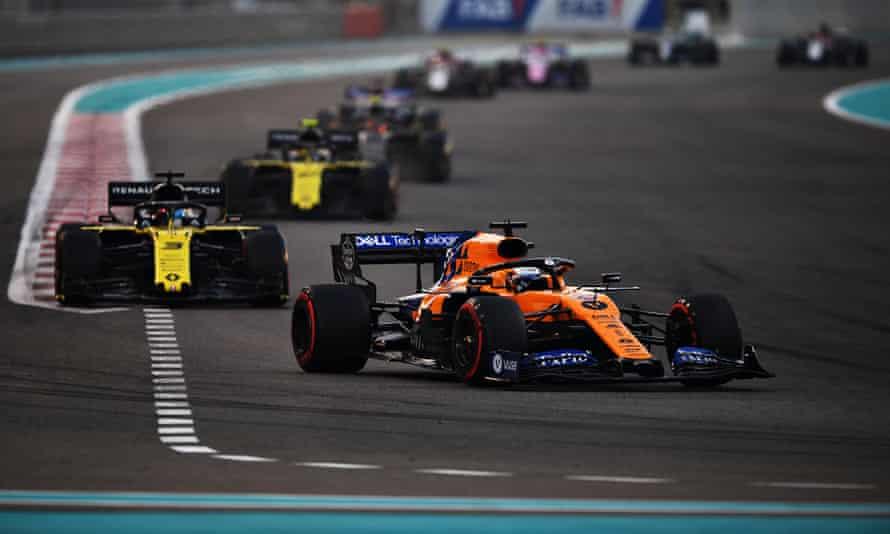 Carlos Sainz leads Daniel Ricciardo's Renault into a turn at the Abu Dhabi Grand Prix in December 2019