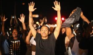 Demonstrators protest the killing of teenager Michael Brown on August 12, 2014 in Ferguson, Missouri.