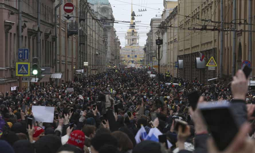 Thousands of people attend a protest against the jailing of Alexei Navalny in St Petersburg on 31 January.