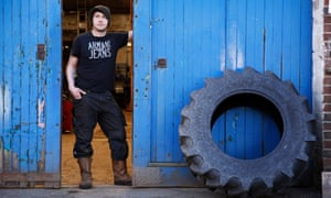 Ali Brown at the garage where he works in Blackwaterfoot, Isle of Arran