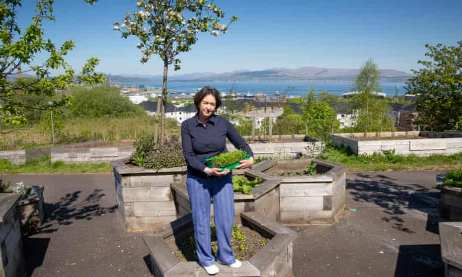 Laura Reilly in the Belville community garden, one of the proposed sites for a coronavirus memorial.