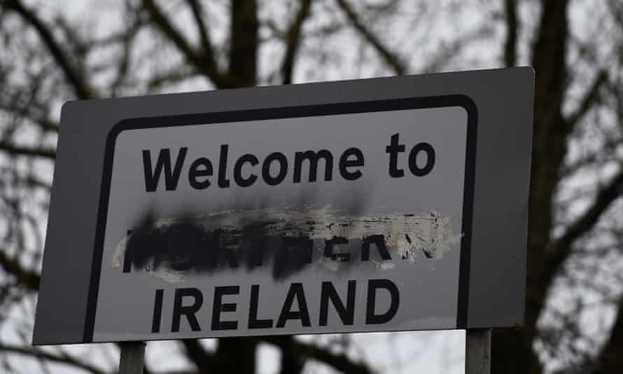 A defaced 'Welcome to Northern Ireland' sign stands on the border in Middletown, Armagh.