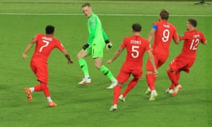 Jordan Pickford is chased by his teammates after he made the decisive save in the penalty shootout against Colombia.