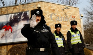 Chinese police outside the Canadian embassy in Beijing.