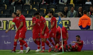 Emre Akbaba is engulfed by his teammates after scoring Turkey's winner against Sweden.