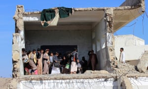 Pupils gather at their school in Saada, Yemen, after it was hit by a Saudi-led airstrike.